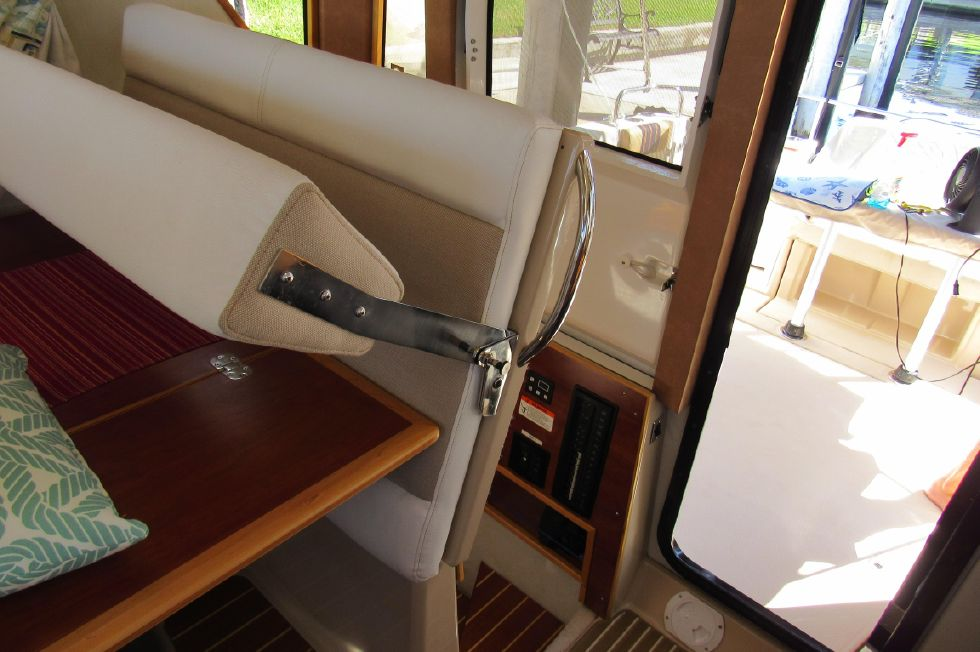 Aft Dinette Seat Folds Up to Access Guest Stateroom