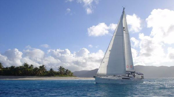 Beneteau 49 Sailing in the lee of a Caribbean island