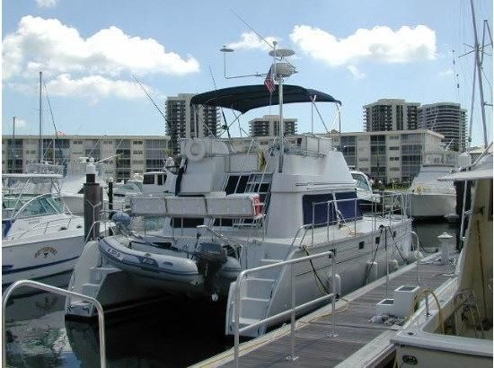 2005 PDQ 34 Power Catamaran - PDQ 34 at the dock