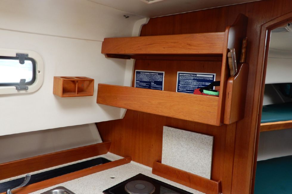 Mainship 34 Pilot galley shelves