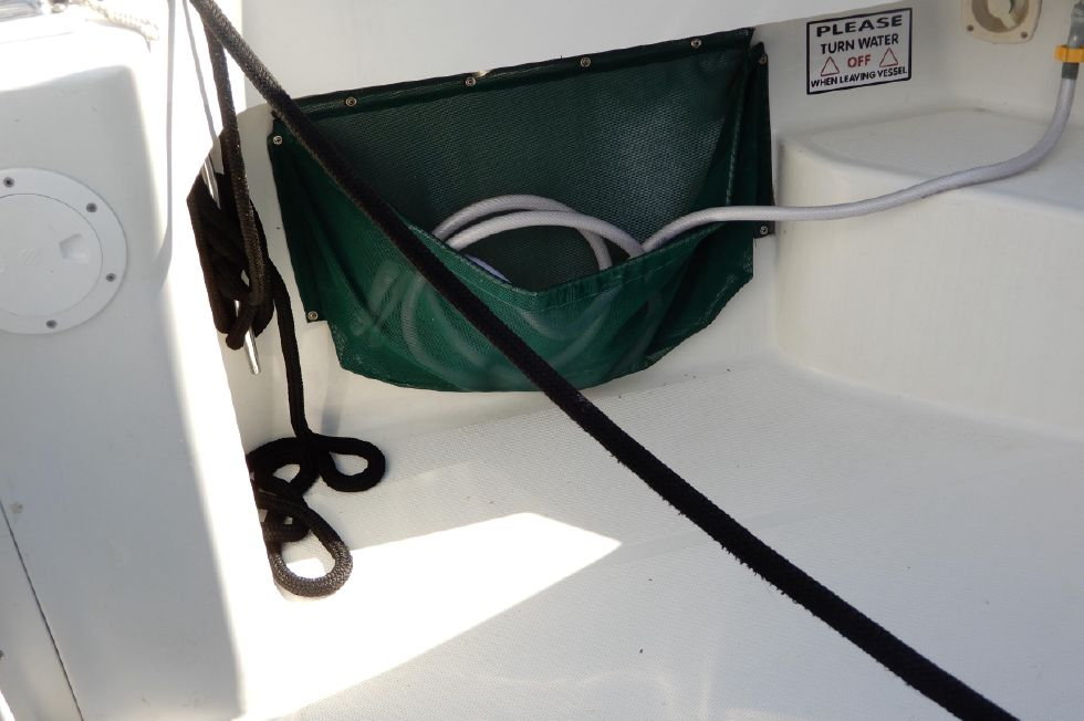 Mainship 34 Pilot aft cockpit fresh water washdown hose in bag