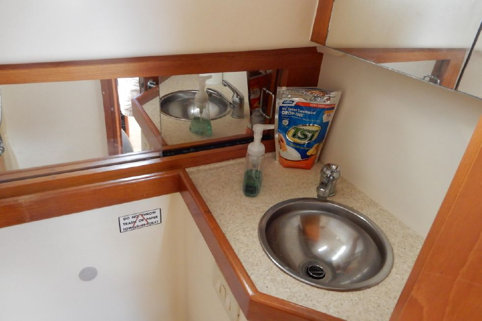 Mainship 34 Pilot head vanity, mirrored cabinets