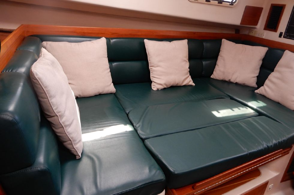 Mainship 34 Pilot salon settee with table lowered for double berth