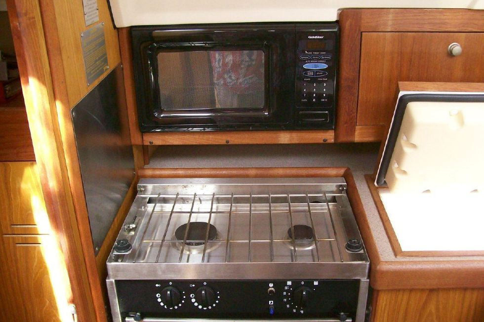 Microwave and 2 Burner Stove/Oven