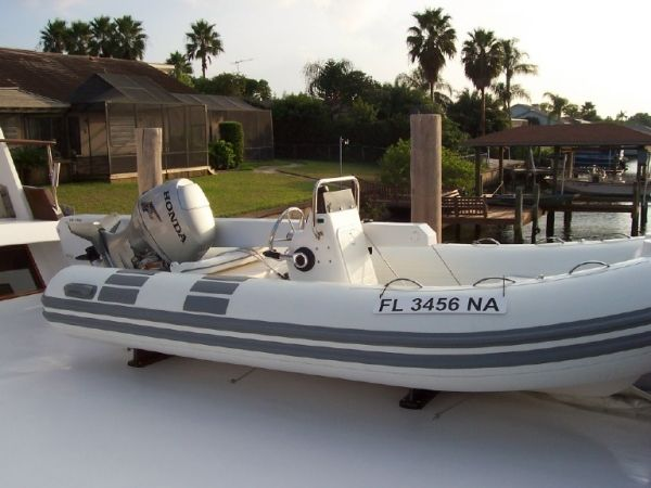 1981 C & L Raised Pilot House - 2004 13' Caribe RIB with a 50 HP four stroke Honda