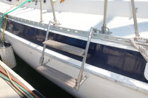 Custom fabricated boarding ladder/steps on port and starboard