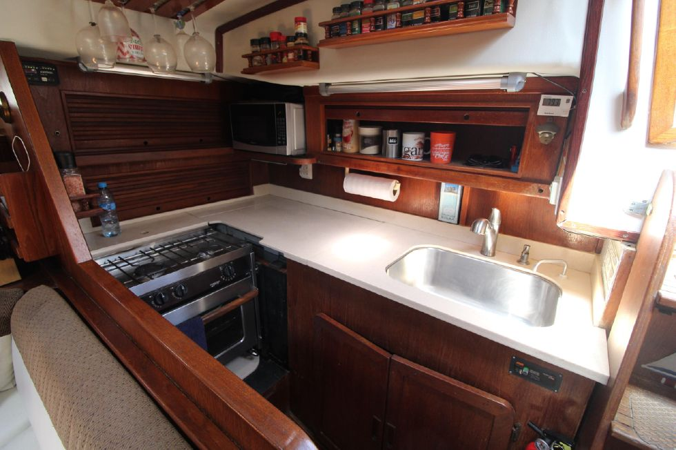 Galley, with propane stove, oven, topload refrigerator, upgraded countertops