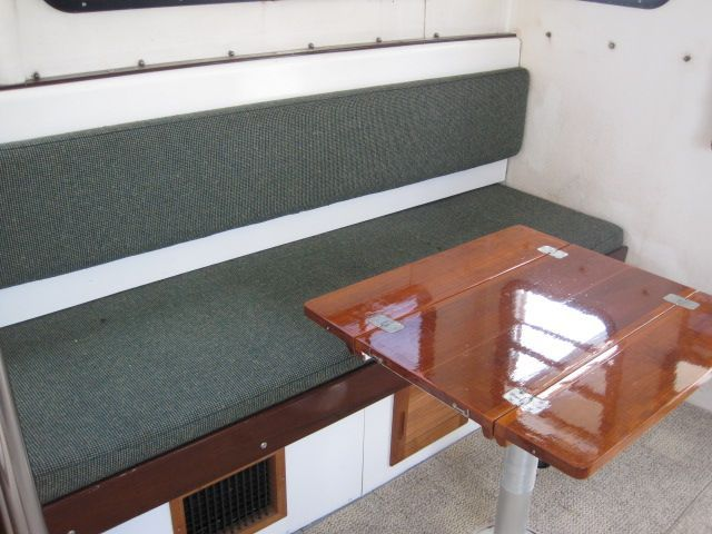 Pilothouse settee with table leaves up