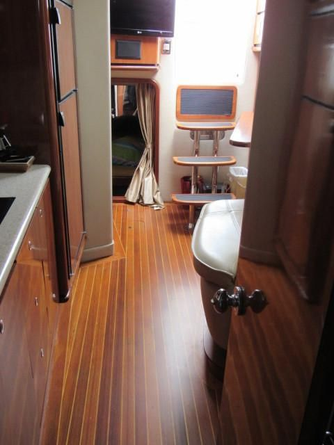 2004 Fountain 48 Express Cruiser - Salon 4 - Teak & Holly Flooring
