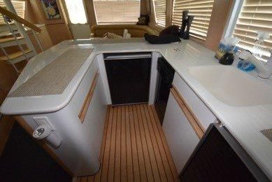 1997 Hatteras Enclosed FB w/ Salon/FB Stairs