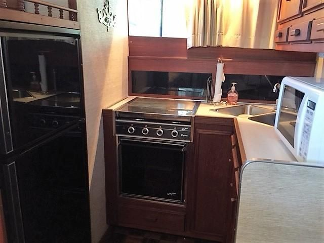 Galley w/ refrigerator, oven, stove & microwave