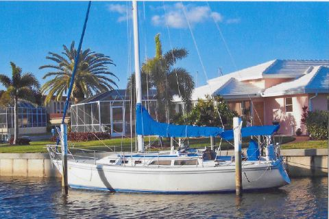 1988 Catalina 34 Sloop - Port side view at her home dock