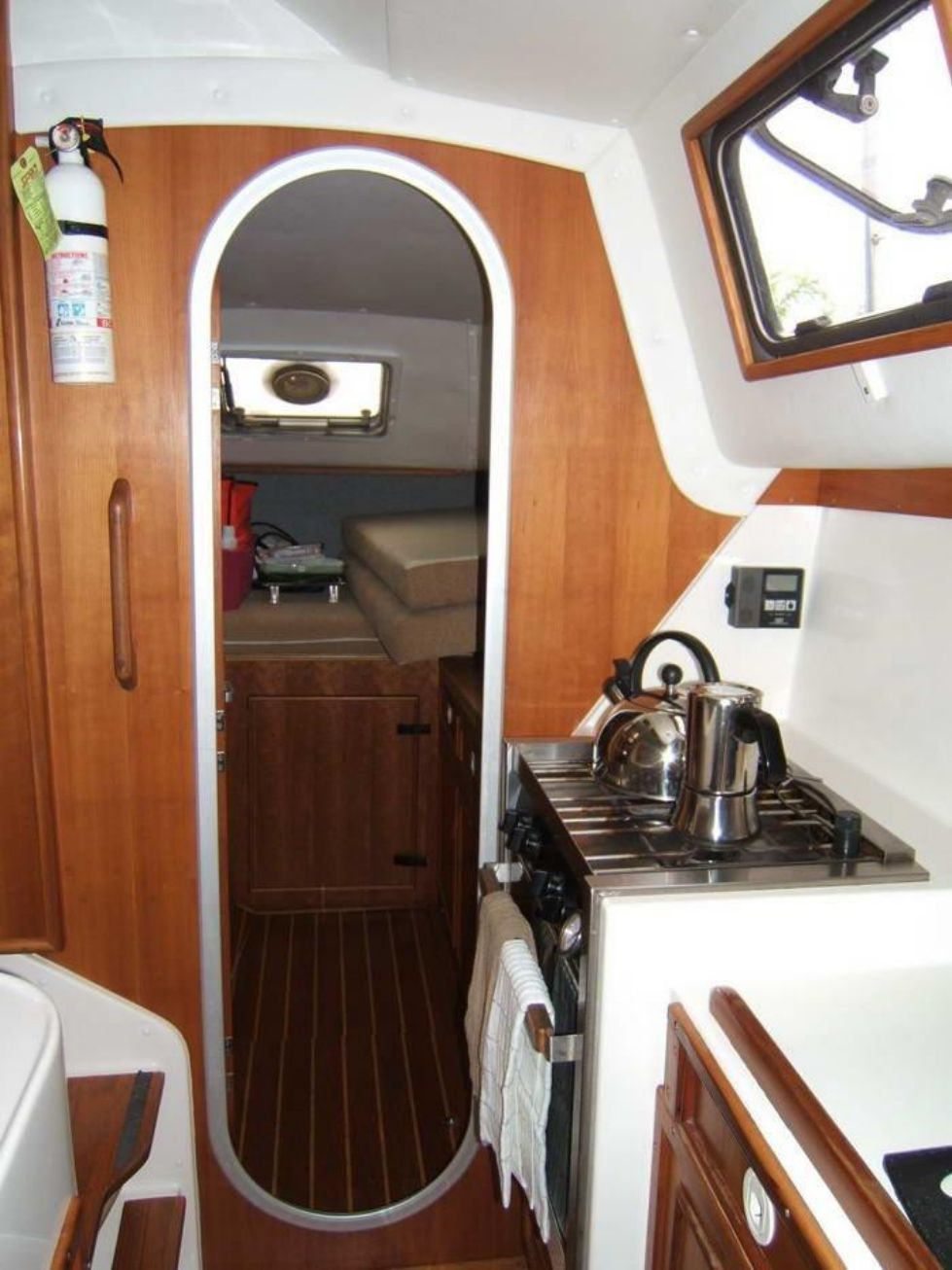1998 PDQ 36 Capella LRC Twin Diesels - PDQ 36 port side galley looking aft