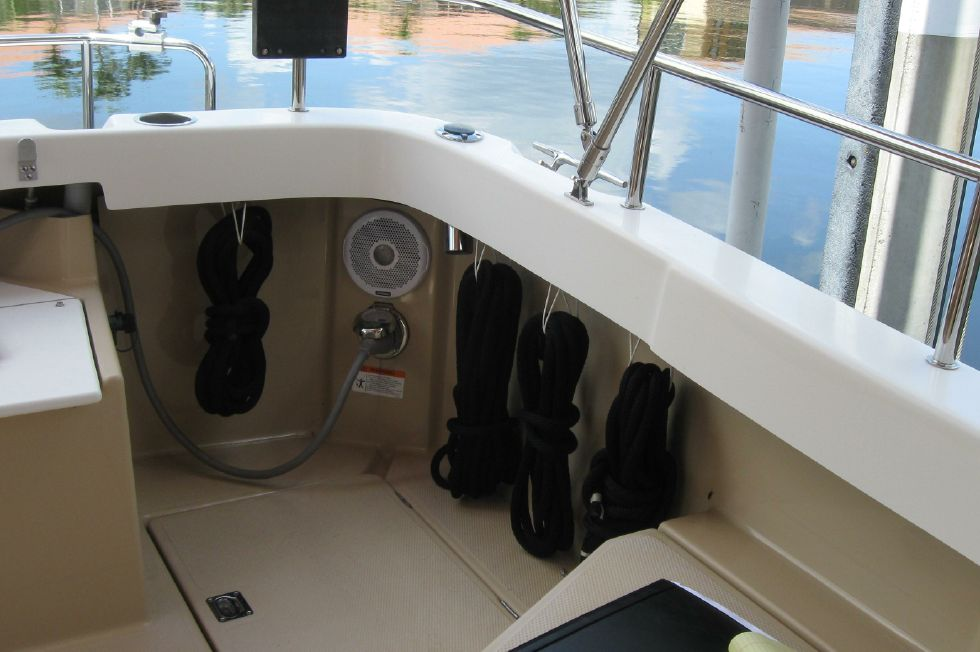2015 Ranger Tugs R-27 - Line and gear storage in aft cockpit