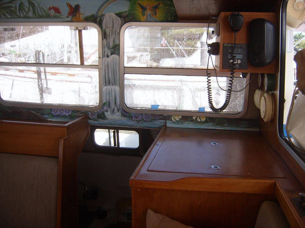 32' Fisher Pilothouse Catamaran+Inside Steering Station
