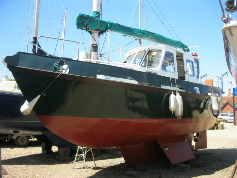 Instant Boats Teal : Teal pilothouse sail boat for sale