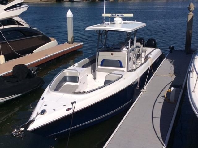 Donzi 38ZFX Sportfisher at dock
